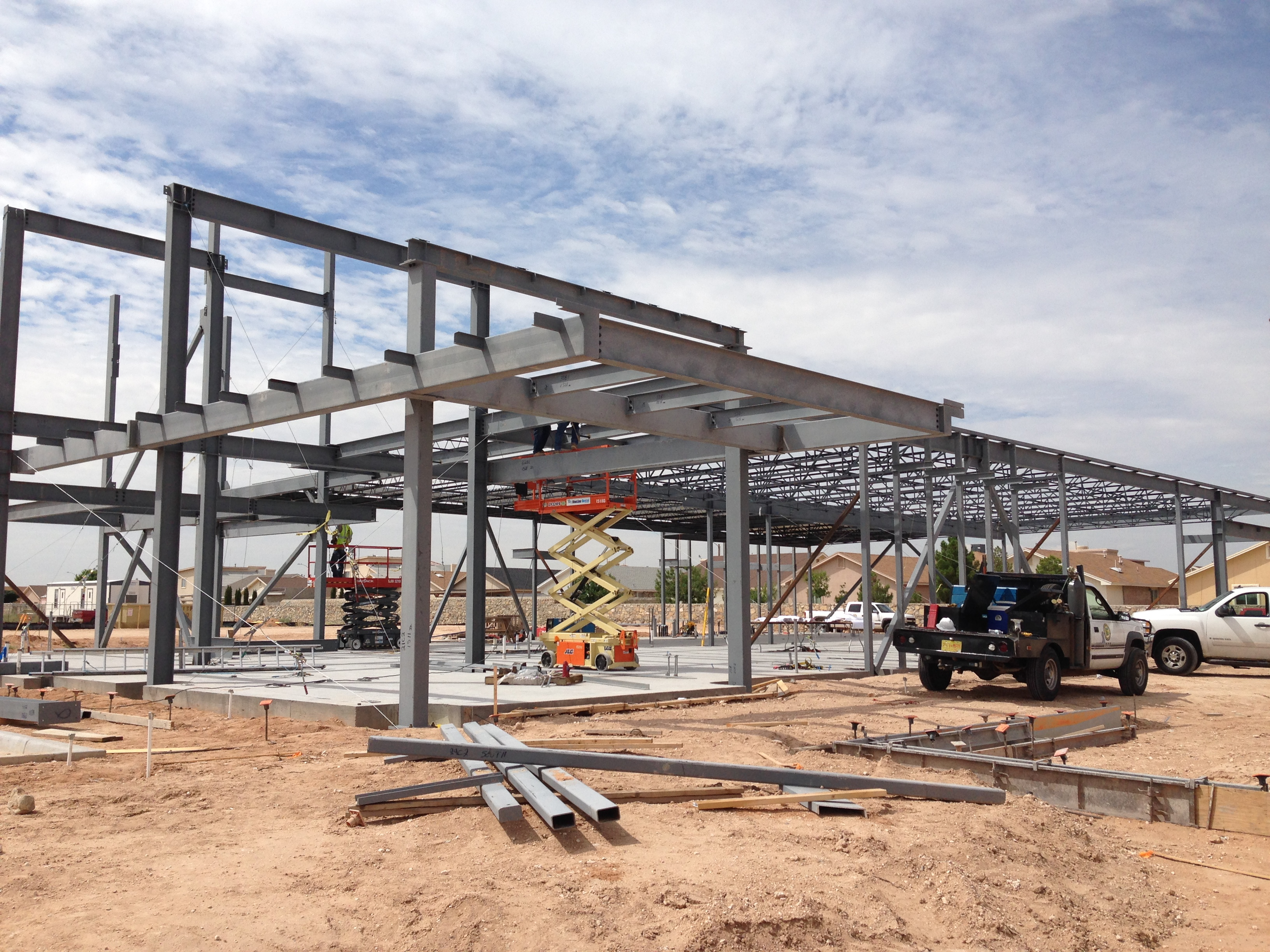 Concrete and steel erection work for a free standing for New construction el paso tx